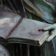 Detail of a grave stone statue — Foto Stock