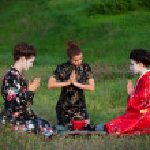 Three women drinking tea in an asian manner — Stock Photo #15870779