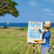 Stock Photo: Young artist finishing his work, outdoor