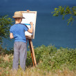 Young artist starting his work, outdoor — Stock Photo