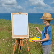 Young artist and blank sheet, outdoor — Stock Photo #15874609