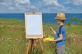 Jonge kunstenaar en leeg vel, buiten — Stockfoto