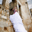 Portrait of beautiful bride under ruins arch — Stockfoto #16509779