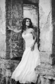 Bride in the old ruins, black and white — Stock Photo