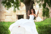 Bride on the swings — Stock Photo