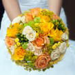 Wedding bouquet with yellow and orange roses — Stock Photo #16676247