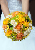 Wedding bouquet with yellow and orange roses — Stock Photo
