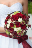 Wedding bouquet with red and white roses — Stock Photo