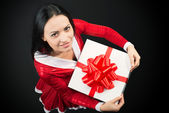 Portrait of a young woman with Christmas present — Stock fotografie