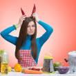 Funny portrait of an angry woman in the kitchen — Stock Photo