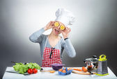 Crazy cooking woman with lemon eyes — Stock Photo