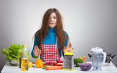 Uncombed depressive woman in the kitchen — Stock Photo