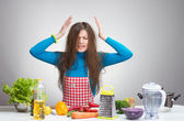 Portrait of a stressed housewife in the kitchen — Stock Photo