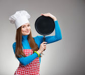 Portrait of a smiling woman with the pan — Stock Photo