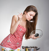 Woman tasting food — Stock Photo