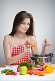 Woman seasoning soup — Stock Photo