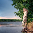 Blond woman on the river bank  — Stock Photo