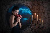 Demonic woman with a pomegranate — Stock Photo