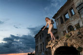 Mysterious woman in the ruins — Stock Photo
