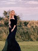 Woman in long black dress — Stock Photo