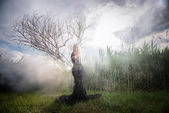 Weird woman in the morning mist — Stock Photo