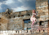 Strange girl in the ruins — Stock Photo