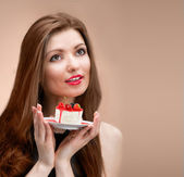 Girl with the cake looking up — Stock Photo