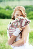 Portrait of a beautiful bride with a fan — Stock Photo