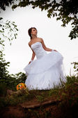 Bride looking away, outdoors — Stock Photo