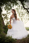 Bride looking down, outdoors — Stock Photo
