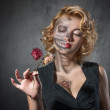 Halloween image. Female portrait with dried flowers — Stock Photo #33314379