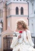 Portrait of princess with a red flower — Foto de Stock