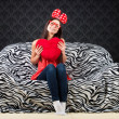 Portrait of a funny girl with a heart cushion — Stock Photo