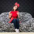 Stock Photo: Portrait of a funny girl with a heart cushion