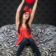 Funny happy girl with a heart cushion — Stock Photo