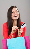 Shopping girl with a credit card — Stock Photo