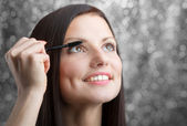 Girl applying mascara — Stock Photo