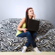 Thoughtful girl with laptop — Stock Photo #43242395