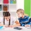 Children writing a test — Stockfoto