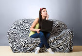 Thoughtful girl with laptop — Stock Photo