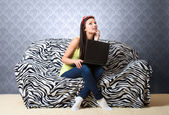 Thoughtful girl with laptop — Stok fotoğraf