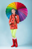 Girl with colorful umbrella — Stock Photo