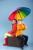 Children with a colorful umbrella — Stock Photo