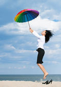 Woman flying away from her problems — Stockfoto