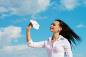 Office lady with a paper plane — Stock Photo