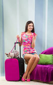 Girl going on vacation with her cat — Stock Photo