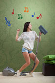 Girl tidies up the room — Stock Photo