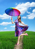 Pretty smiling girl with colorful umbrella — Stock Photo