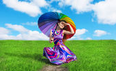 Pretty girl with colorful umbrella resting on the road — Stock Photo