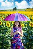 Portrait of a girl with colorful umbrella — Stockfoto